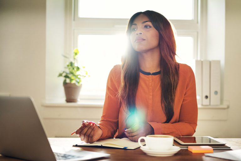 young-female-entrepreneur-thinking-while-working