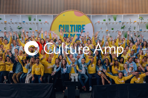 Culture Amp team photo with logo over the top